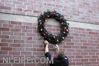 Wreath being hung at Fire Station 1