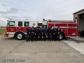 Members of the NLFPD in front of the new engine.